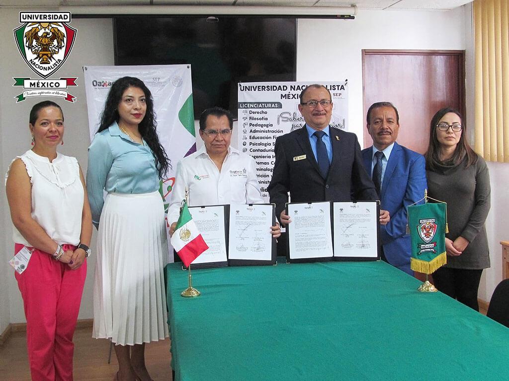 Firma del Convenio UNM - CECYTEO llevado a cabo el día 3 de junio del 2019 por el Dr. C. H. Eduardo Contreras García, Rector de la Universidad Nacionalista México y el Lic. Paulo Tapia Palacios, Director General del Colegio de Estudios Científicos y Tecnológicos del estado de Oaxaca (Cecyte Oaxaca).